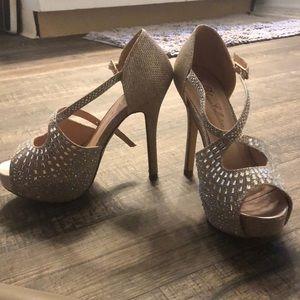 Size 6 heels. Only worn twice.